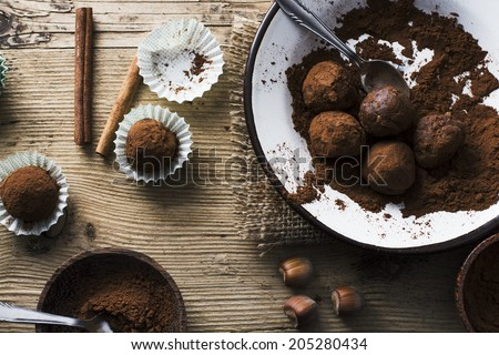 Chocolate Balls on wooden background - stock photo