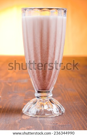 chocolate banana cocktail on brown board at sunset - stock photo