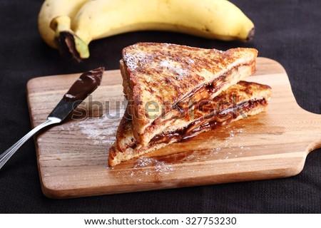 chocolate banana french toast with whole wheat bread - stock photo