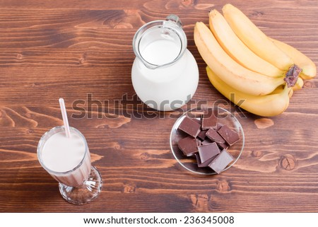 chocolate banana milk shake banana chocolate brown board top view - stock photo