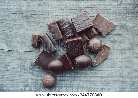 chocolate bar, candy bars,  different chocolate sweets on a wooden background - stock photo