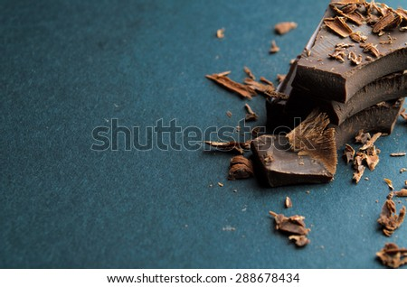 Chocolate bar, chips and powder. Shallow depth of field. - stock photo