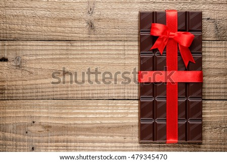 Chocolate bar on wooden background