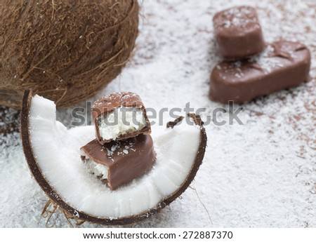 chocolate bar with coconut filling. Shallow dof - stock photo