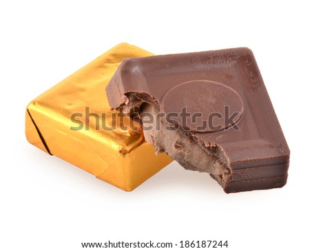 Chocolate bars in gold foil isolated on white