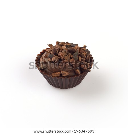 Chocolate basket with cacao isolated on white.