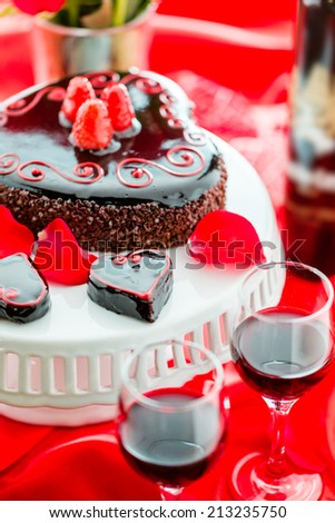 Chocolate beer and wine pairings. Flourless Cake with Zinfandel wine for Valentines day. - stock photo