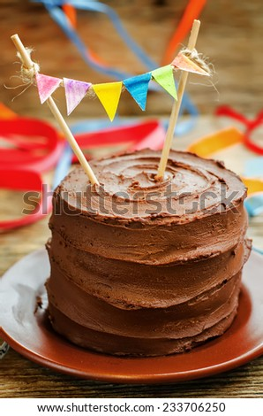 chocolate birthday cake on a dark wood background. toning. selective focus - stock photo