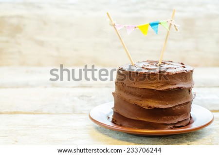 chocolate birthday cake on a white wood background. toning. selective focus - stock photo