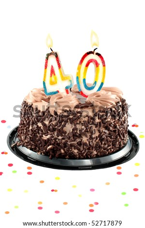 Chocolate birthday cake surrounded by confetti with lit candle for a fortieth birthday or anniversary celebration - stock photo