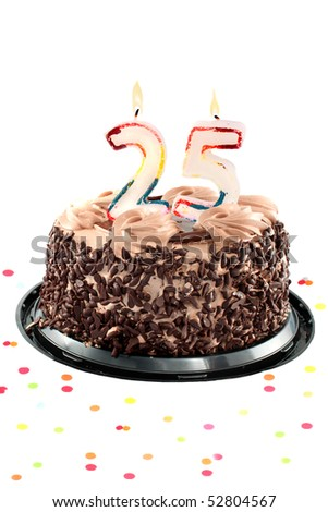 Chocolate birthday cake surrounded by confetti with lit candle for a twenty fifth birthday or anniversary celebration - stock photo