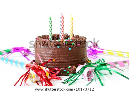 Chocolate Birthday cake with candles and noise makers on a white background. - stock photo