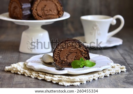 Chocolate biscuit roll with chocolate cream. - stock photo