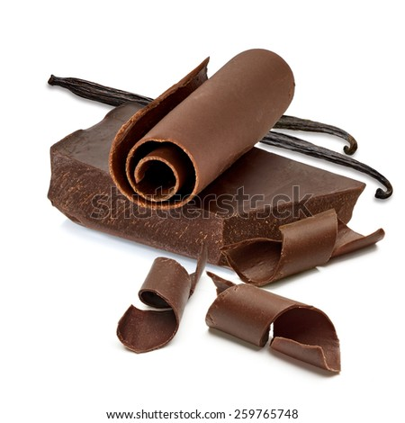 Chocolate block and curls with vanilla beans on white background - stock photo