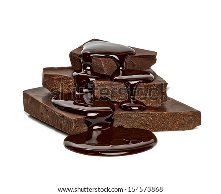 Chocolate blocks with sauce flow on white background - stock photo