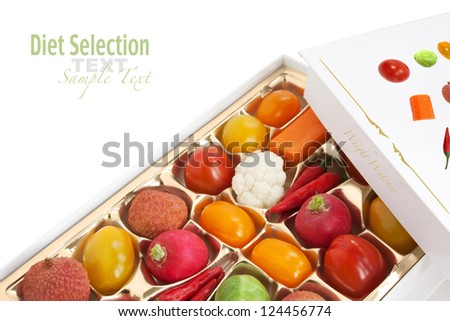 Chocolate box with vegetable and fruit contents - humorous diet concept - stock photo