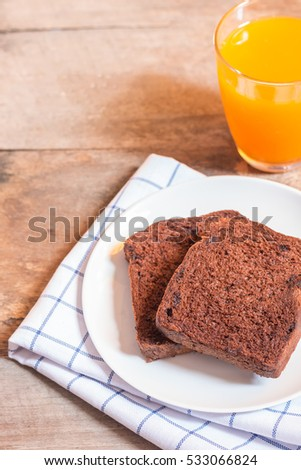 Chocolate Bread and orange juice on wooden background