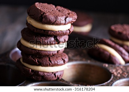 Chocolate brownie cookies with peanut butter filling - stock photo