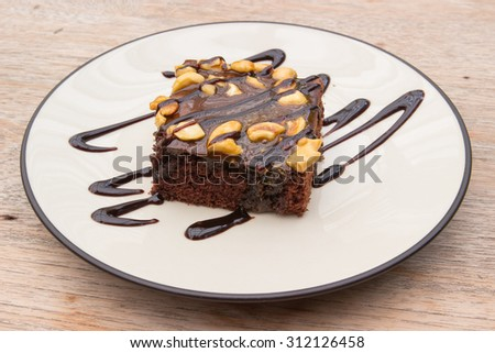 Chocolate brownie on the wooden background - stock photo