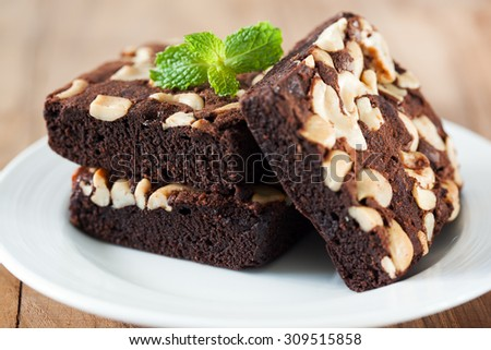 chocolate brownie with almond in plate  - stock photo