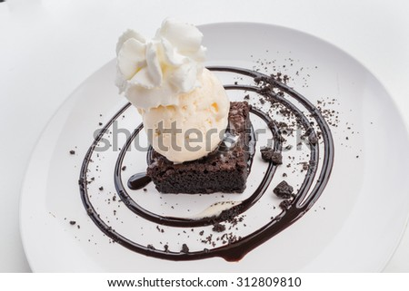 Chocolate Brownie  with ice cream and whipped cream - stock photo