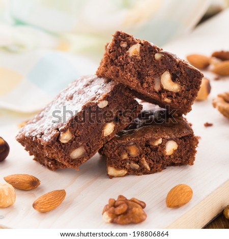 Chocolate brownie with nuts - stock photo