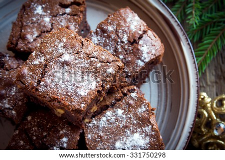 Chocolate brownie with nuts and powdered sugar for Christmas time - stock photo