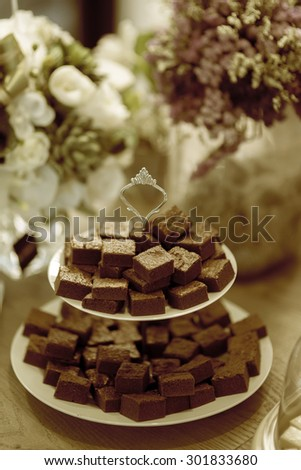 Chocolate Brownies on tray - High tea or afternoon tea dessert - stock photo