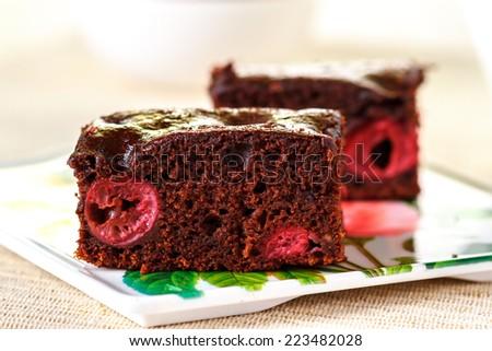 Chocolate brownies with cherries - stock photo