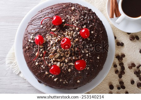 chocolate cake and coffee on the table. horizontal view from above closeup  - stock photo