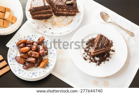 Chocolate cake and dried dates fruit. - stock photo