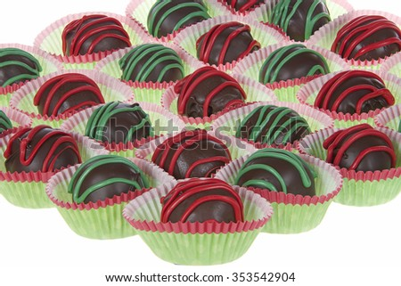 Chocolate Cake Balls stripped with red and green candy melts for a festive Christmas Holiday design isolated on white background - stock photo