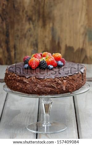 Chocolate cake decorated with fresh fruits - stock photo