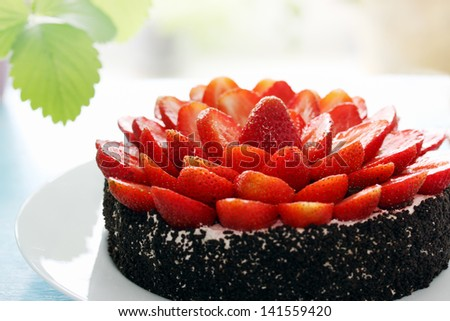 Chocolate cake decorated with fresh juicy strawberries - stock photo