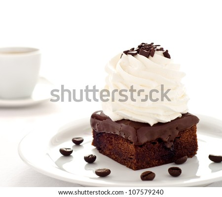 Chocolate cake dessert with coffee and whipped cream - stock photo