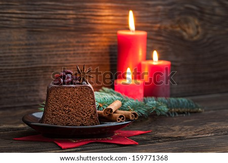 chocolate cake for christmas with candles  - stock photo