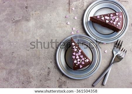 Chocolate cake for romantic dinner on Valentines day, top view, copy space - stock photo