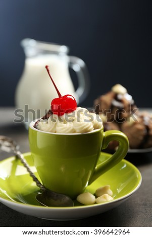 Chocolate cake in a mug with a cherry on top, close up - stock photo