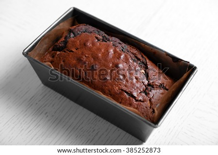 Chocolate cake in baking dish on white table