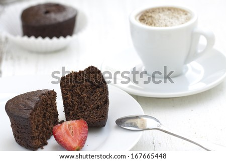 Chocolate cake on a plate, ready to eat - stock photo