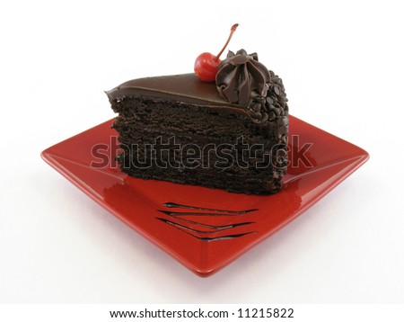 Chocolate cake on a red plate isolated on white