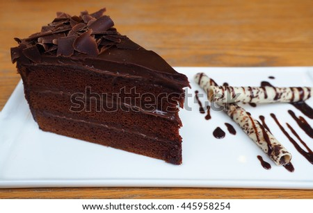 Chocolate cake on a white plate decorate wafer roll topped chocolate - stock photo