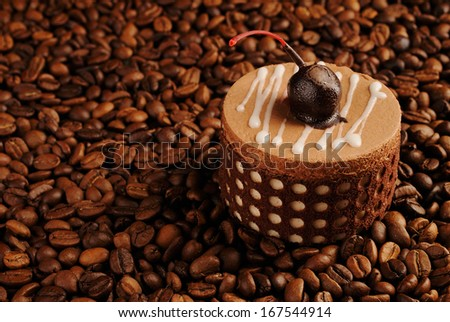 chocolate cake on coffee beans as a background - stock photo