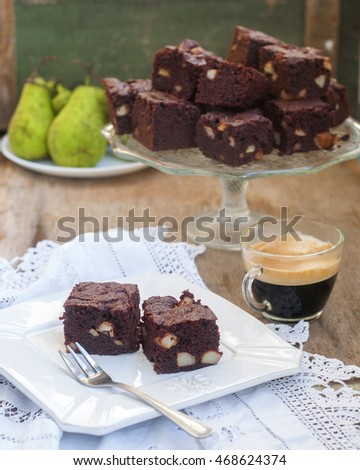 Chocolate cake or brownies with pear, selective focus