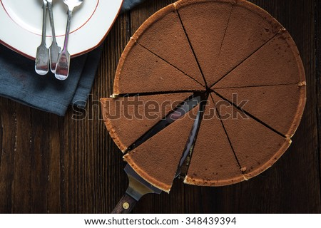 Chocolate cake sliced from above with fresh cocoa - stock photo