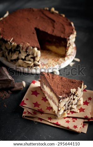Chocolate cake. Vintage dessert tart with chocolate and almonds