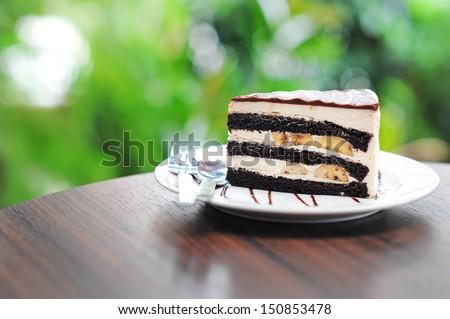 Chocolate cake with banana. - stock photo