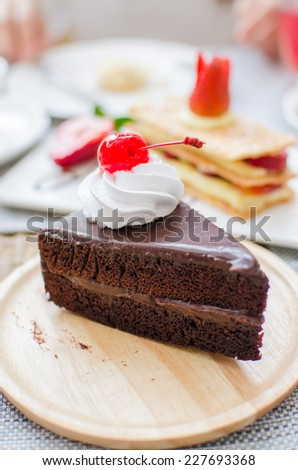 Chocolate cake with cherry and whipped cream - stock photo