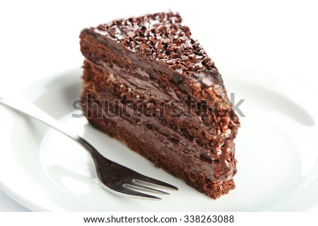 Chocolate cake with chocolate cream  on plate isolated on white - stock photo