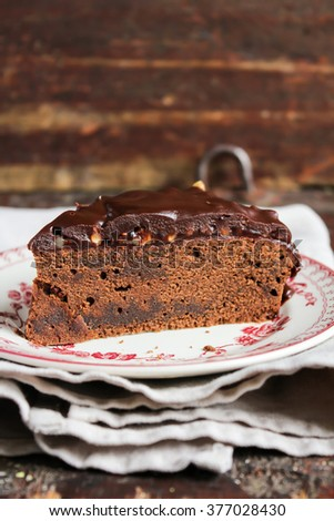 Chocolate cake with cream, nuts and jam, selective focus - stock photo